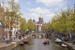 Canal and nicolaaskerk in amsterdam red light district Royalty Free Stock Photos