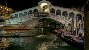 Canal night scene in Venice Italy. Canal night scene from bridge of Rialto in Venice Italy royalty free stock images