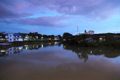 Canal at night. View of the old communities along the canal Chanthaburi at night Stock Photo
