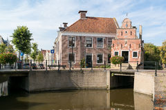 Canal with old house in Franeker, Netherlands Royalty Free Stock Image