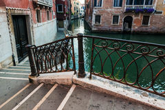 Canal among old  houses, Venice Stock Photo