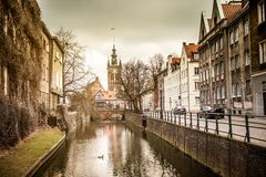 Canal in the old town of Gdansk, Poland. Canal and old historic buildings in the old town of Gdansk, Poland Royalty Free Stock Photos