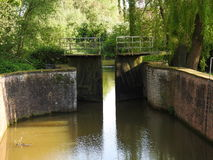 Canal and old water lock. Canal with water lock in Bornem - Belgium Stock Photo