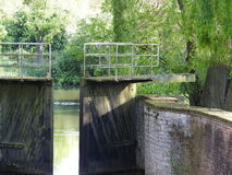 Canal and old water lock. Canal with water lock in Bornem - Belgium Stock Image