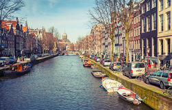 Canal perspective in spring sunny day Royalty Free Stock Images