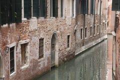 Canal and Red Brick Facade, Venice Stock Photos