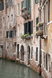 Canal and Red Brick Facade, Venice Stock Image
