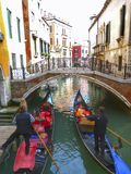 Canal ride on gondolas in Venice, Italy. Queit canal ride in the streets of old town of Venice in Italy Stock Photos