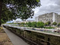 Canal Saint Martin, boats and builings in Paris France