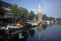 Canal scene. Boats & clock tower,MontelbaanstorenAmsterdamNetherlands stock images
