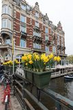 Canal scene with a bicycles and traditional Dutch houses in Amsterdam. Netherlands. Amsterdam, Netherlands - April 20, 2017: Canal scene with a bicycles and stock photo
