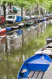 Canal scene with boats houses amsterdam holland Stock Photos