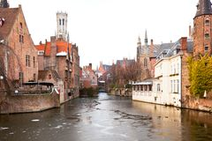 Canal scene in Bruges, Belgium. Winter Canal scene in Bruges, Belgium. Horizontal shot With the Belfry Tower in the background Stock Photography