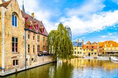 Canal scene with surrounding medieval buildings in the medieval city of Bruges, Belgium. Brugge/Belgium - Sept. 18 2018: Canal scene with surrounding medieval stock photos