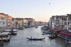Canal scene in Venice Italy. Canal scene and boats from bridge of Rialto in Venice Italy royalty free stock photos