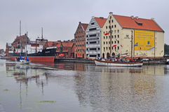 Ships in Harbour. Canal of the old harbour in Gdansk in northern Poland. Old steamer museum ship and a sailing yacht on the left. Old schooner on the right Royalty Free Stock Image