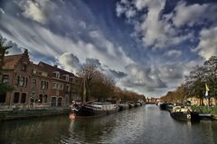 Canal with Ships. View of a typical canal with ships and houses in Bruges, Belgium royalty free stock image