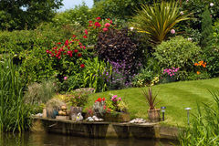 Free Canal Side Garden Royalty Free Stock Images - 13089069