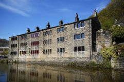 Canal side homes. Traditional stone built Pennine houses backing on to the canal in Hebden Bridge, West Yorkshire Royalty Free Stock Photo