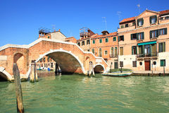 Canal and small bridge in Venice, Italy. Stock Image