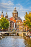 Canal and St. Nicolas Church in Amsterdam Stock Photo