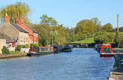 The canal at Stoke Bruerne. Barges or narrow boats on the canal at Stoke Bruerne in Northamptonshire, UK. This is a popular destination for tourists Stock Image