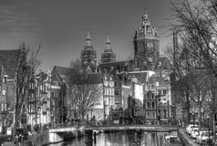 Canal Street with Basilica of St. Nicholas in Amsterdam Netherlands HDR Stock Photos
