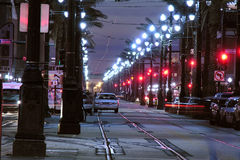 Canal Street Night. NEW ORLEANS LOUISIANA - DECEMBER 12, 2005:  Police cars stand watch at night on Canal Street Stock Photos