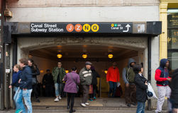 Canal street subway entrance. NEW YORK - MAY 2, 2016: Unknown people in front of the entrance of Canal Street subway in chinatown, Manhattan royalty free stock image