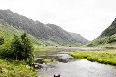 The canal is surrounded by the great mountain. Glencoe, the land of peace Stock Photo