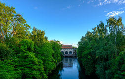 A canal surrounded by trees Royalty Free Stock Photo