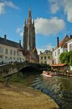 Canal tour of Bruges. Boat tour on the canal of Bruges, a medieval town of Belgium Stock Image
