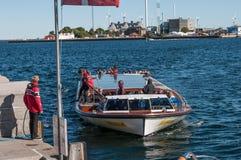 Canal tours boat arriving to pier in Copenhagen Denmark Stock Photos