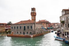 Canal and tower view  in Murano island, street, boats Royalty Free Stock Photos