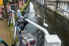 Canal with tunnel and street with bicycle parking lot in Dutch Delft old city Royalty Free Stock Photo