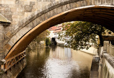 Canal Under Charles Bridge. Underneath the landmark Charles Bridge in Prague, a number of small canals exist to serve some of the old mills such as the one stock images
