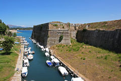 The canal under the old fortress of Corfu, Greece. Boats in the canal under the old fortress of Corfu, Greece Royalty Free Stock Photos