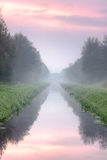 Canal under pink clouds Stock Photo