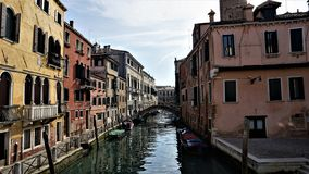 Canal and venetian houses in its typical architecture in Venice, Italy stock images