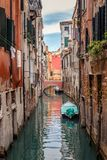 Canal in Venezia with houses and boat. Typical view of a Venetian canal with ancient houses and boat Stock Photos