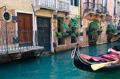 Canal in venice. Romantic canal in venice with a black traditional gondola Royalty Free Stock Photo