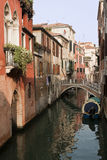 Canal in Venice. Sunlit buildings alongside a canal in Venice stock images
