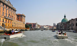 Canal in venice. Shot of a canal with boats and gondolas Royalty Free Stock Image