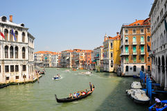 Canal in venice. Shot of a canal with boats and gondolas Stock Photo