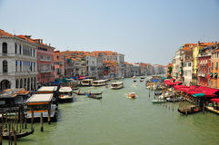 Canal in venice. Shot of a canal with boats and gondolas Royalty Free Stock Images