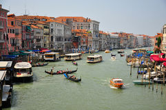 Canal in venice. Shot of a canal with boats and gondolas Royalty Free Stock Photos