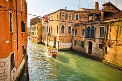 Canal in Venice. Illuminated by sunlight Stock Photo