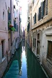Canal in Venice. Very narrow canal in Venice Royalty Free Stock Photography