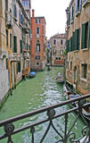 Canal in Venice. Narrow canal with gondolas in Venice Stock Images
