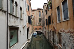 Canal in Venice with docked gondola and boats, Royalty Free Stock Photos